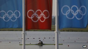A rower from Sweden practices on a single sculls boat at the 2012 Summer Olympics in Eton Dorney, near Winsdsor,