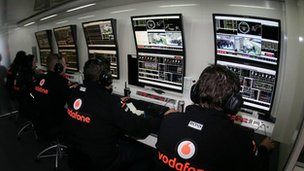 F1 engineers in garage