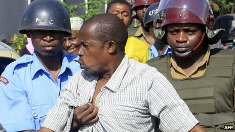  A sympathiser of the Mombasa Republican Council is arrested by riot-police on 24 April 2012 following violent confrontations in Kenya&#039;s coastal town of Mombasa