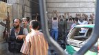 Free Syrian Army opposition fighters detain policemen after overrunning the Shaar district police station in Aleppo on 25 July