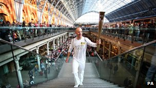 Luke Corduner holding the Olympic Flame