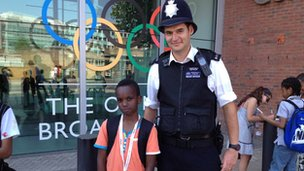 School Reporter with policeman