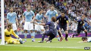 Japan's Yuki Otsu scores against Spain