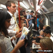 People on a London tube train