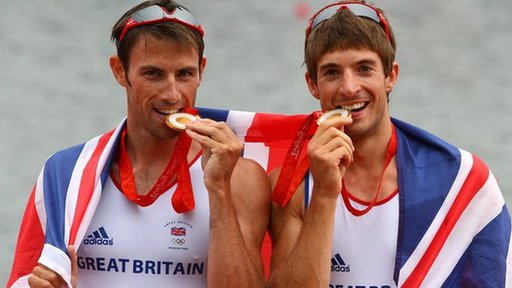 Zac Purchase biting his gold medal with rowing partner Mark Hunter