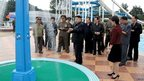 North Korean leader Kim Jong-un (c) is shown in the company of his wife, Ri Sol-ju (r, in red jacket) and officials at the Rungna People's Pleasure Ground in Pyongyang, in an undated picture released by the official news agency KCNA on 26 July 2012