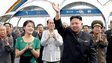 North Korean leader Kim Jong-un (c) is shown in the company of his wife, Ri Sol-ju (front left) and officials at the Rungna People's Pleasure Ground in Pyongyang, in an undated picture released by the official news agency KCNA on 26 July 2012