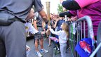 Sir Clive Woodward passes the torch to a little girl.
