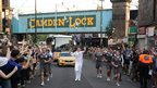 Darren Fitzpatrick carries the flame at Camden Lock