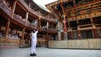 Ifeyinwa Egesi holds the Olympic Flame inside the Globe Theatre