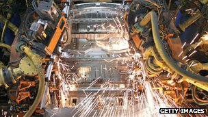 Robots weld a car at a GM plant in Michigan