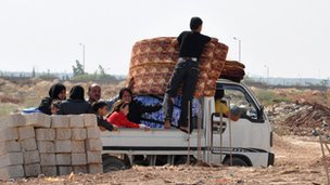 Syrian civilians flee the northern city of Aleppo (image from 25 July 2012)