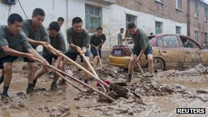Chinese soldiers clear mud in Hougoumen village, Fangshan district, in Beijing
