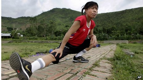 Indian boxer and five-time world champion Mary Kom warms up before she practices boxing at her residence in Langol Games village on the outskirts of Imphal