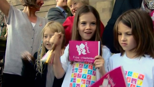People ring bells in Edinburgh to mark the start of the Olympic Games