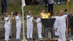 Sir Matthew Pinsent lighting the cauldron