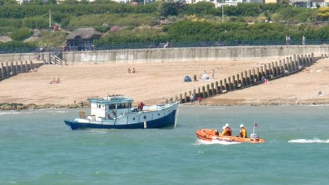 The cruiser and a RNLI rigid inflatable boat