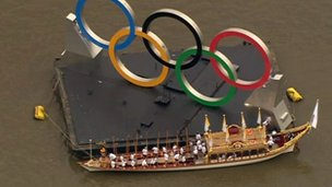 Gloriana beside the huge Olympic rings