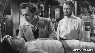 Scene from 1957 film The Curse of Frankenstein, featuring Peter Cushing as the baron and Christopher Lee as the monster 
