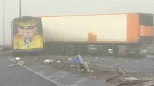 Coach and lorry at crash scene