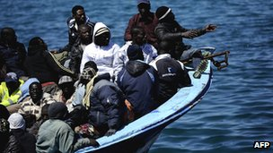 Migrants from Libya arriving on the Italian island of Lampedusa on 9 April 9 2011