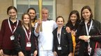 The pupils of Wilmslow High School standing with torchbearer Mike Dooling.