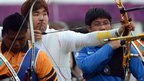South Korean Im Dong-Hyun (centre) prepares to shoot
