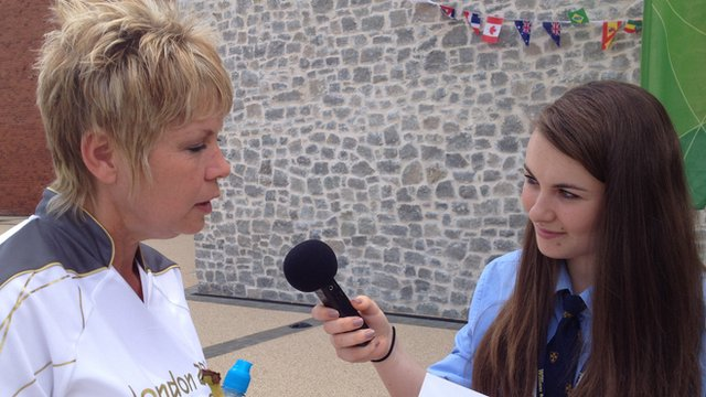 A School Reporter interviews a torchbearer in Much Wenlock