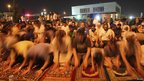 Syrian refugees and local residents perform night prayers during the holy month of Ramadan before a protest in front of the Syrian Embassy in Amman July 26