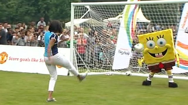 Michelle Obama playing football