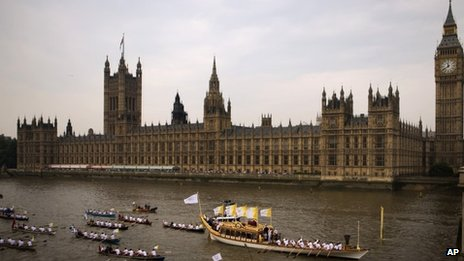 The Queen's rowbarge Gloriana outside the Houses of Parliament