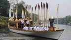 Olympic flame on the Queen&#039;s rowbarge Gloriana