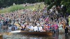 Crowds line the banks of the river Thames 