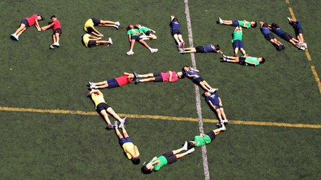 Garden International pupils braved the scorching sun to spell out this message to Merlin on their school field!
