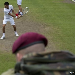 Soldier watching Novak Djokovic practice at Wimbledon