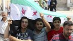 Anti-Assad protesters at funeral of three-year-old Bilal El-Labloubi, in al Ramtha, Jordan, 27 July 2012