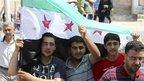 Anti-Assad protesters at funeral of three-year-old Bilal El-Labloubi, in al Ramtha, Jordan, 27 July 2012