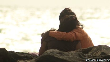A couple in an in intimate embrace at Bandra Land's End in Mumbai