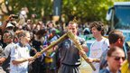 Torchbearers pass on the flame in Camberwell, London. Photo: Tony'Tk'Smith