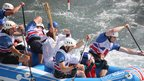 Olympic torch carried on a white water raft. Photo: Peter Wootton