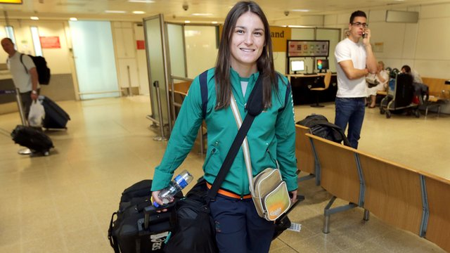 Ireland s boxing gold medal favourite katie taylor arrives in london