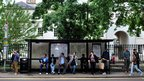 People queuing at a bus stop in Greenwich, London
