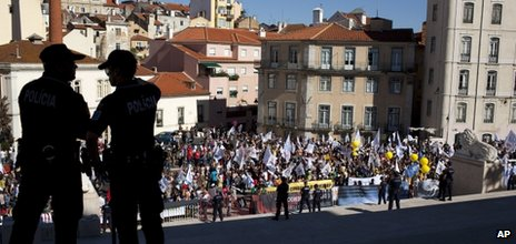 Protesters arrive in front of the Portuguese parliament in Lisbon, Thursday, 12 July 2012, during a teachers demonstration protesting the government's education budget cuts. (AP Photo