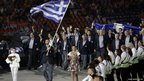 Greece&#039;s Alexandros Nikolaidis carries his national flag during the Opening Ceremony 