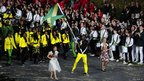 Jamaica&#039;s Usain Bolt carries their flag