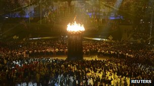 Athletes parade next to the Olympic flame at London 2012 Opening Ceremony