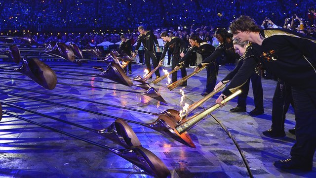 Seven young athletes light the Olympic caldron