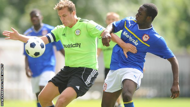 Jamie Collins of Forest Green Rovers competes with Cardiff City's Jessie Darko