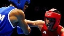 Anthony Ogogo [r] in Olympic action against Junior Castillo Martinez