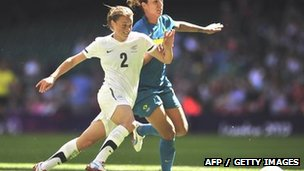 Brazil goalscorer Cristiane (R) vies with New Zealand defender Ria Percival at the Millennium Stadium